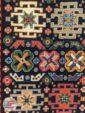نمای نزدیک از فرش ماشینی دستباف گونه زمینه سرمه ای کد 108