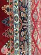 حاشیه فرش ماشینی طرح قشقایی زمینه لاکی کد 104