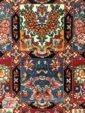 نمایی نزدیک از فرش ماشینی طرح دستباف زمینه سرمه ای کد 110